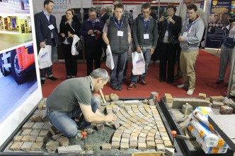 Andrea Angheben - Director of the Trentino Board of Control - demonstrating traditional porphyry cube laying on our stand at the Natural Stone Show 2013
